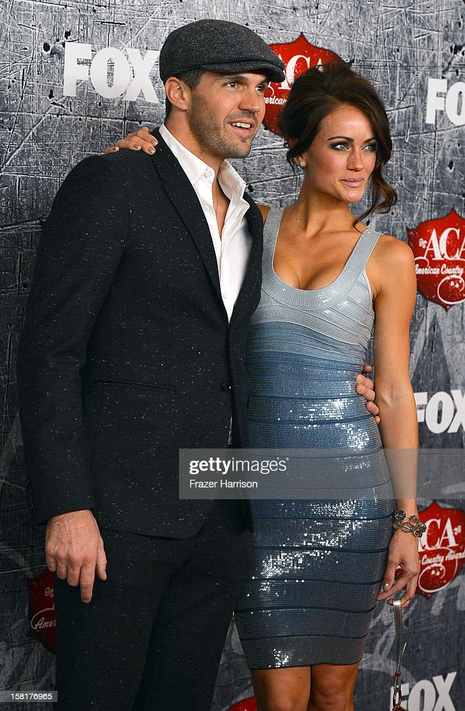 Major League Baseball pitcher Barry Zito (L) and his wife Amber Seyer arrive at the 2012 American Country Awards at the Mandalay Bay Events Center on December 10, 2012 in Las Vegas, Nevada.