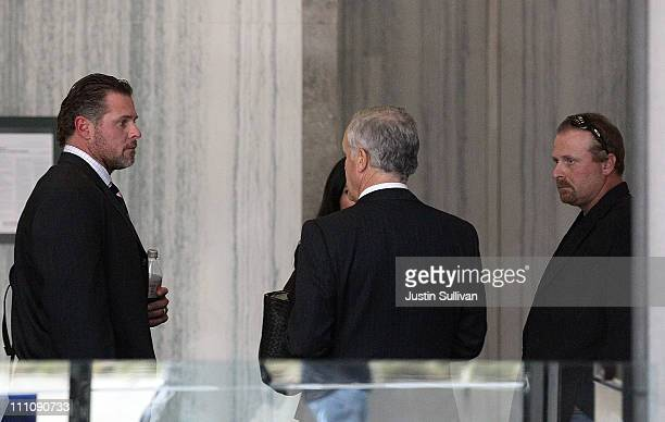 Major League Baseball player Jason Giambi and his brother Jeremy Giambi talk with their attorney before leaving federal court after testifying during...
