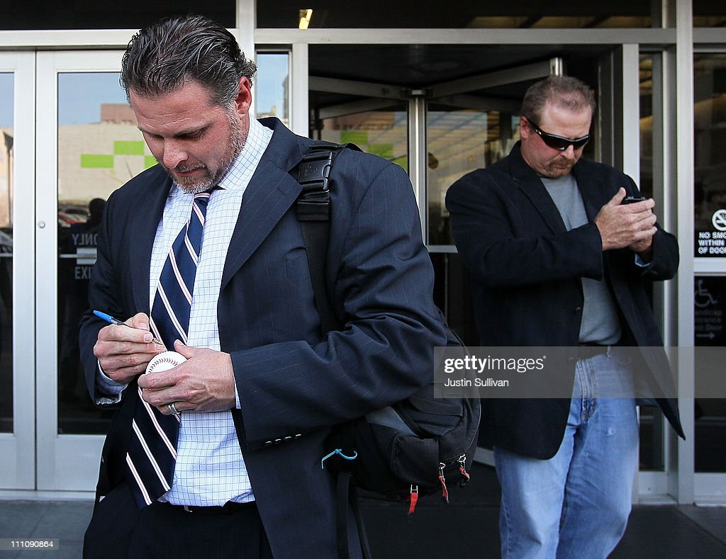 Major League Baseball player Jason Giambi (L) signs an autograph as he and his brother Jeremy Giambi (R) leave federal court after testifying during Barry Bonds' perjury trial on March 29, 2011 in San Francisco, California. Barry Bonds' perjury trial accusing him of lying to a grand jury about his use of performance enhancing drugs when he played for the San Francisco Giants enters its second week. The trial is expected to last two to four weeks.