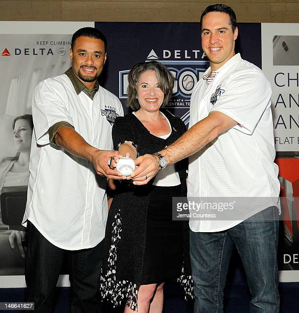 Major league Baseball player Johan Santana Senior Vice President of Delta Airlines Gail Grimmett and major league baseball player Mark Teixeira...