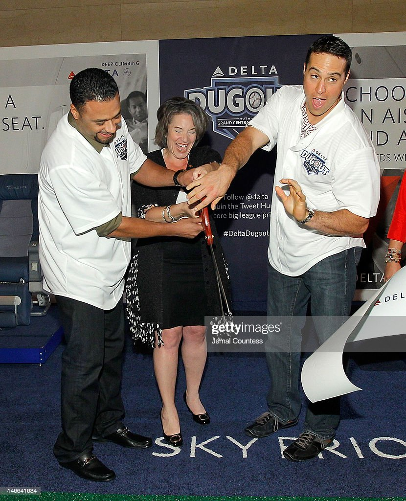 Major league Baseball player Johan Santana, Senior Vice President of Delta Airlines Gail Grimmett and major league baseball player Mark Teixeira cut the ribbon at the opening of the Delta Dugout at Vanderbilt Hall at Grand Central Terminal on June 21, 2012 in New York City.