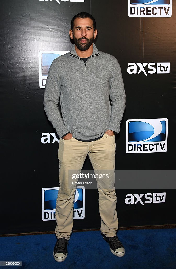 Major League Baseball player Jose Bautista attends DirecTV Super Saturday Night hosted by Mark Cuban's AXS TV and Pro Football Hall of Famer Michael Strahan at Pendergast Family Farm on January 31, 2015 in Glendale, Arizona.
