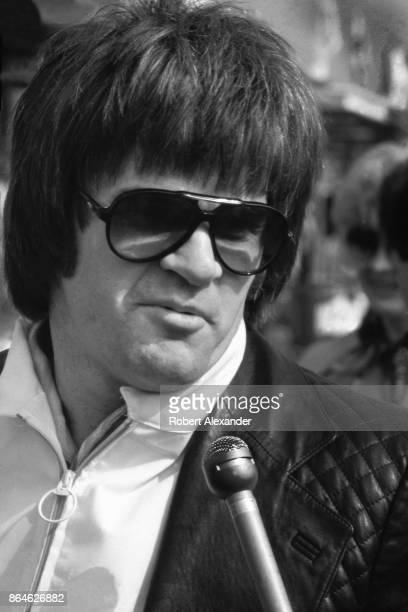 Major League Baseball player Pete Rose talks with a reporter at the 1981 Daytona 500 NASCAR race at Daytona International Speedway in Daytona Beach...