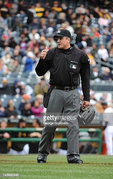 Major League Baseball umpire Mike DiMuro signals during a game between the St Louis Cardinals and Pittsburgh Pirates at PNC Park on April 22 2012 in...