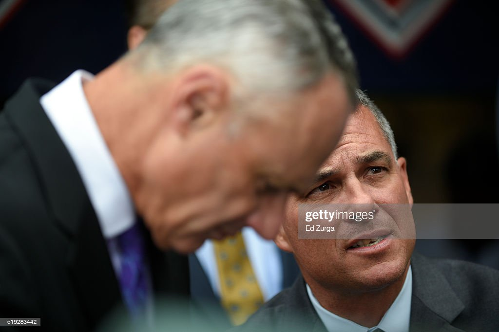 Major League Commissioner <a gi-track='captionPersonalityLinkClicked' href=/galleries/search?phrase=Rob+Manfred&family=editorial&specificpeople=2707217 ng-click='$event.stopPropagation()'>Rob Manfred</a> listens to Kansas City Royals General Manager <a gi-track='captionPersonalityLinkClicked' href=/galleries/search?phrase=Dayton+Moore&family=editorial&specificpeople=4308708 ng-click='$event.stopPropagation()'>Dayton Moore</a> prior to the World Series Championship rings presentation to the Royals prior to a game against the New York Mets at Kauffman Stadium on April 5, 2016 in Kansas City, Missouri.