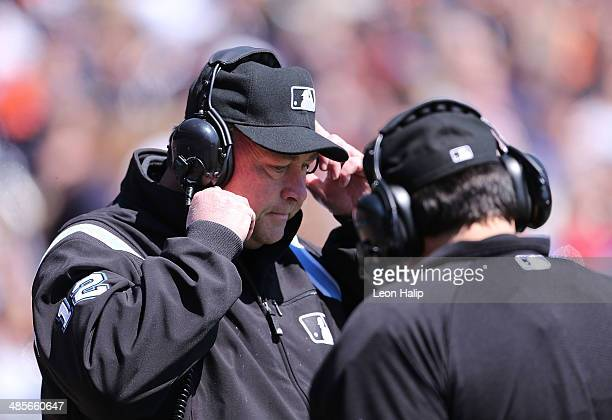 Major League Umpire Gerry Davis uses the instant replay review system to check on a challanged call made during the game between the Los Angeles...