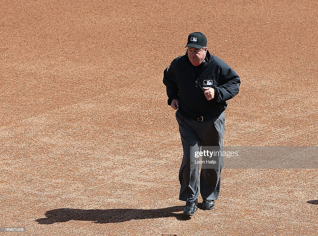 Major League Umpire Joe West runs towards home plate during the game between the Minnesota Twins and the Detroit Tigers at Comerica Park on May 25...