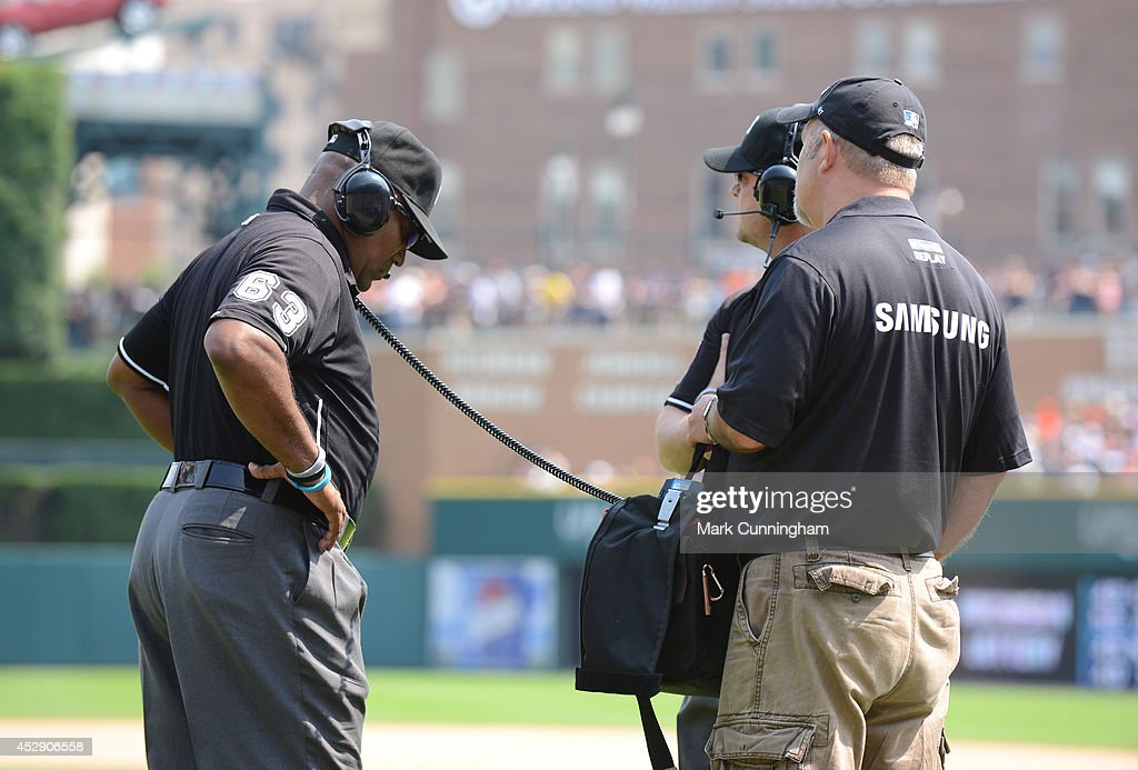 Major League Umpire <a gi-track='captionPersonalityLinkClicked' href=/galleries/search?phrase=Laz+Diaz&family=editorial&specificpeople=541436 ng-click='$event.stopPropagation()'>Laz Diaz</a> #63 stands on the field for an instant replay review during the game between the Cleveland Indians and the Detroit Tigers at Comerica Park on July 20, 2014 in Detroit, Michigan. The Tigers defeated the Indians 5-1.