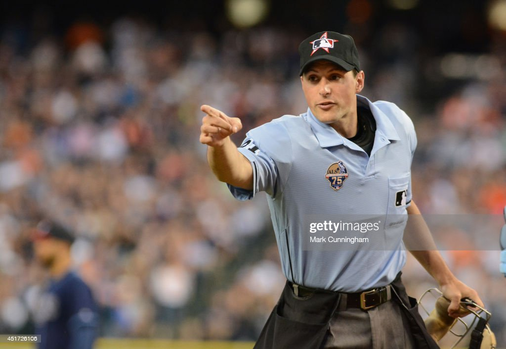 Major League umpire Quinn Wolcott looks on during the game between the Detroit Tigers and the Tampa Bay Rays at Comerica Park on July 4, 2014 in Detroit, Michigan. The Rays defeated the Tigers 6-3.