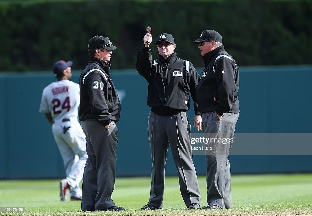 Major League Umpires Rob Drake Mike Estabrook and Hunter Wendelstedt meet between innings of the gane between the Cleveland Indians and the Detroit...