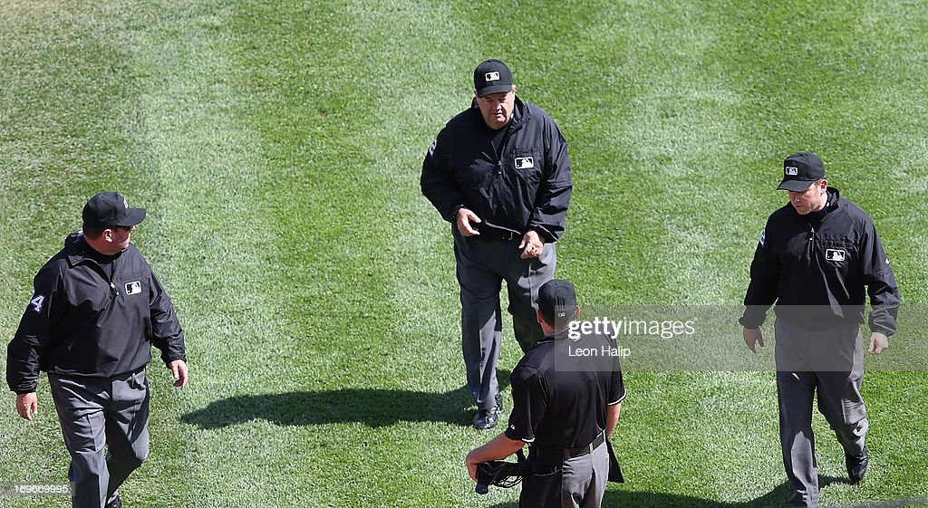 Major League Umpires Sam Hollbrook Joe West Clint Fagan and Home Plate Umpire Andy Fletcher meet to review a home run call during the game between...