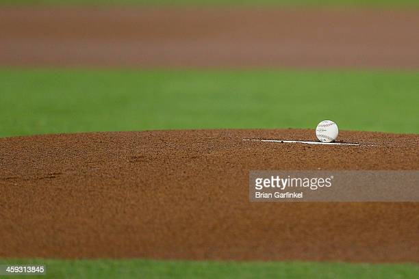 Major Leagye Baseball sits on the pitchers rubber on the mound before the game between the Atlanta Braves and the Philadelphia Phillies at Citizens...