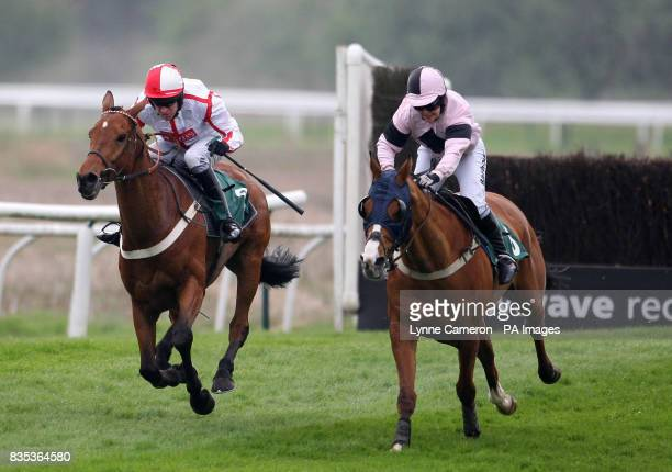 Major Miller ridden by Barry Geraghty goes on to win the stanjamescom Novices' Handicap Chase ahead of Guns and Butter ridden by Rose Dobbin during...