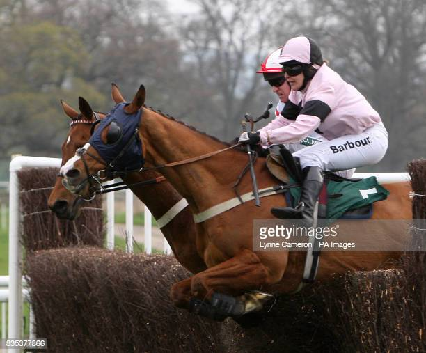 Major Miller ridden by Barry Geraghty goes on to win the stanjamescom Novices' Handicap Chase ahead of Guns and Butter riden by Rose Dobbin