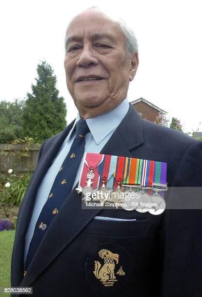 Major Neville Hogan a former Chindit soldier in Burma shows off his medals at his home in Hemel Hempstead Hertfordshire Burmeseborn Hogan was just...