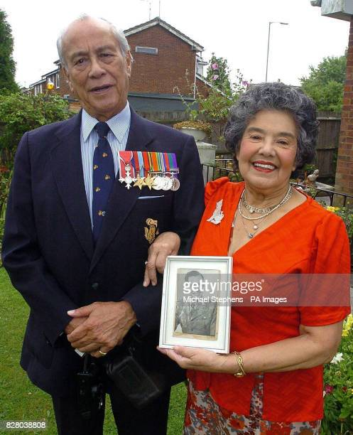 Major Neville Hogan a former Chindit soldier in Burma with his wife Glory at his home in Hemel Hempstead Burmeseborn Hogan was just 16yearsold when...