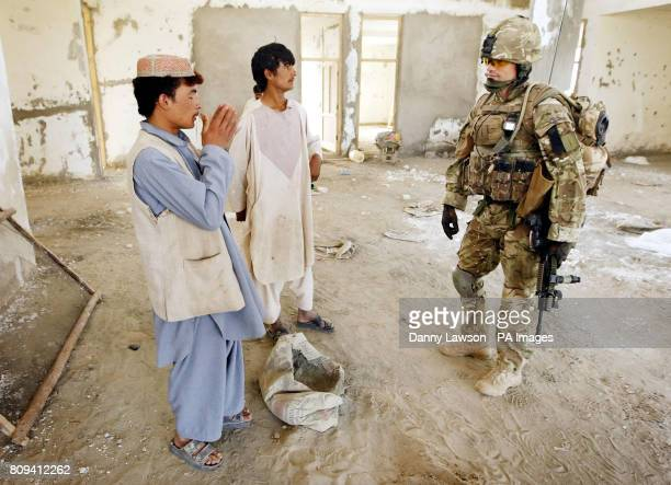Major Nik Cavill of XRay Company 45 Commando Royal Marines at the building site of a new school in the village of Siadabad while on patrol from...