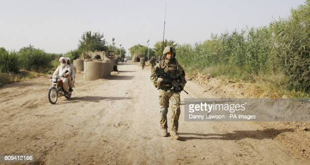 Major Nik Cavill of XRay Company 45 Commando Royal Marines in the village of Siadabad while on patrol from Patrol Base Kalang in Afghanistan