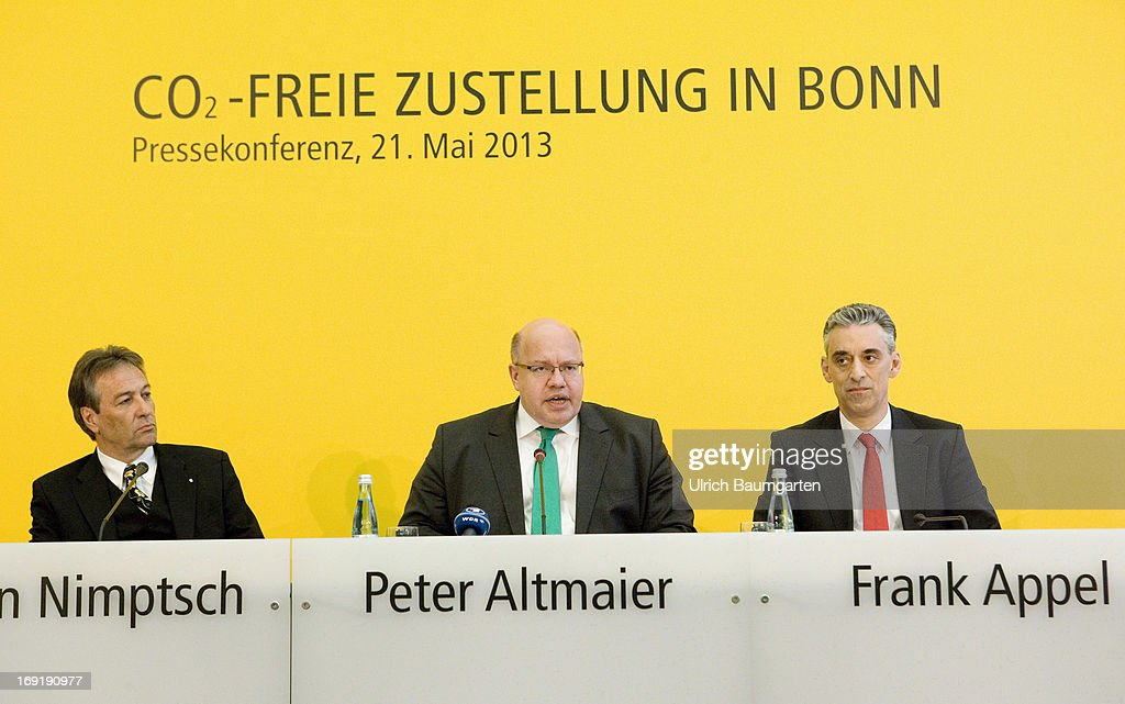Major of Bonn Juergen Nimptsch (SPD), Federal Minister of Environment Peter Altmaier (CDU and Frank Appel, CEO of the Deutsche Post DHL, attend a press conference as Deutsche Post launch carbon-neutral mail delivery with electric commercial vehicles on May 21, 2013 in Bonn, Germany. Initially 79 vehicles will be put into service in Bonn and the surrounding area for delivery.