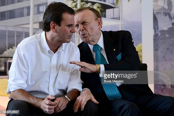 Major of Rio de Janeiro Eduardo Paes and the President of the 2014 World Cup Local Organising Committee Jose Maria Marin talk during the laying of...