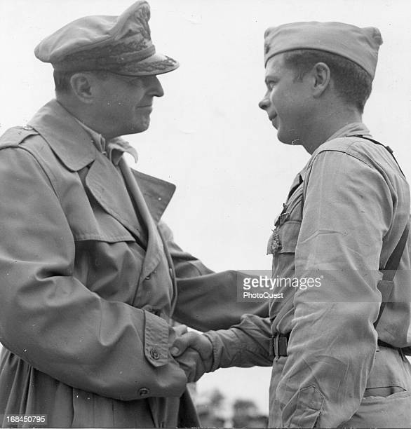 Major Richard Bong shakes hands with General Douglas MacArthur after receiving the Medal of Honor December 1944