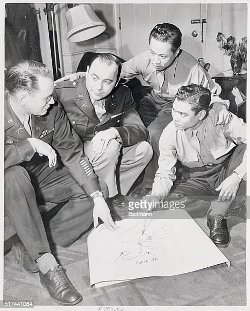 Major Roy C Tuggle of Princeton West Virginia a survivor of the Bataan 'death march' and two Filipino Guerilla Officers discussing their parts in the...