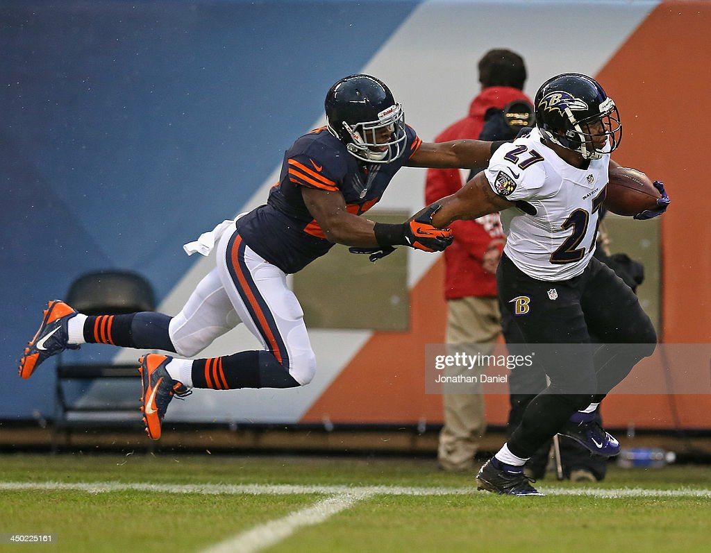 Major Wright #21 of the Chicago Bears forces Ray Rice #27 of the Baltimore Ravens out of bounds on a long gain at Soldier Field on November 17, 2013 in Chicago, Illinois.