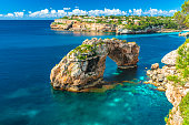 view of the natural landmark, Es Pontas, natural rock arch on Mallorca island, Spain