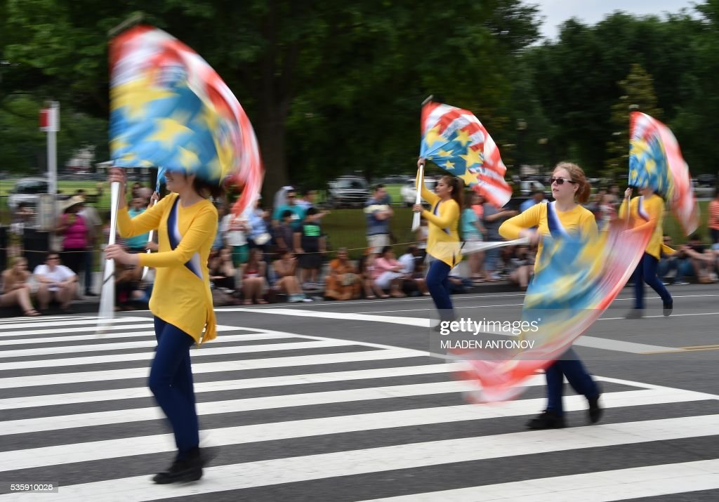 Majorette perform during the Memorial Day Parade on Constitution Avenue on May 30, 2016 Washington DC. / AFP / MLADEN