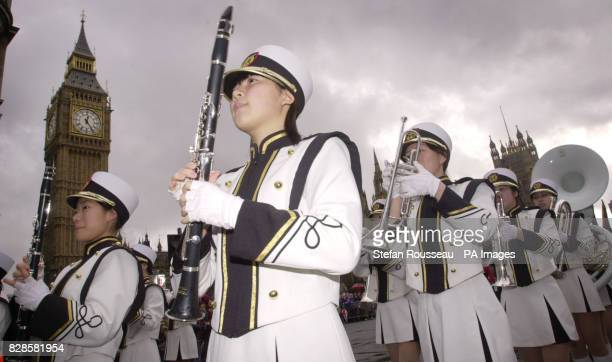 Majorettes from all over the world brave the wet weather in London during this year's New Year's Day parade More than 10000 performers endured a damp...