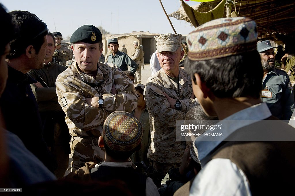 MajorGeneral Nick Carter Commander of ISAF Regional Command and Brigadier General Larry Nicholson Commanding Officer of 2nd Marine Expeditionary...