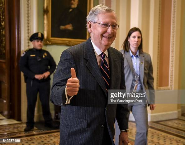 Majority Leader Sen Mitch McConnell sticks his thumb up as he departs the Senate floor after the vote on Education Secretary Betsy DeVos on February...
