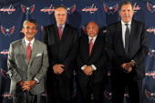 Majority Owner Ted Leonsis General Manager Brian MacLellan Coach Barry Trotz and President Dick Patrick all of the of the Washington Capitals pose...