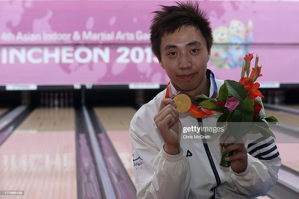 Mak Cheuk Yin of Hong Kong, China celebrates with his gold medal after defeating Kim Junyung of Korea during the Men's Singles Bowling final at Anyang Hogye Gymnasium on day two of the 4th Asian Indoor & Martial Arts Games on June 30, 2013 in Incheon, South Korea.