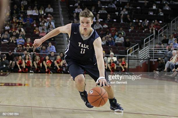 Makai Mason of the Yale Bulldogs pushes the ball up the court against the USC Trojans in a NCAA college basketball game at Galen Center on December...
