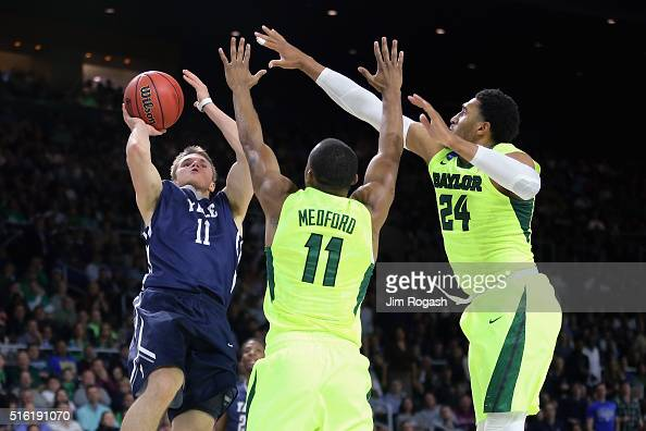 Makai Mason of the Yale Bulldogs shoots the ball as he is defended by Lester Medford of the Baylor Bears and Ishmail Wainright in the first half of...