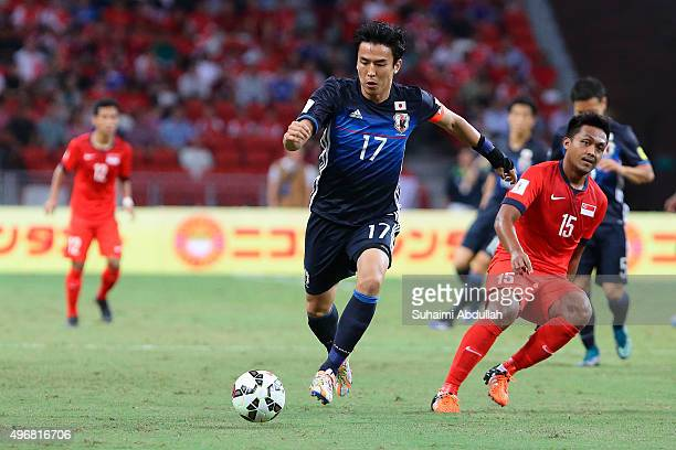 Makato Hasebe of Japan in action during the 2018 FIFA World Cup Qualifier match between Singapore and Japan at National Stadium on November 12 2015...