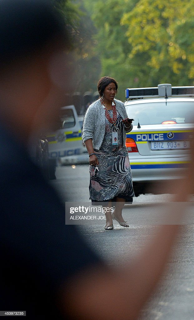 Makazawie Mandela, a daughter of late former South African president Nelson Mandela, is pictured in front of his home in Johannesburg on December 6, 2013 where he died the day before. Mandela, the revered icon of the anti-apartheid struggle in South Africa and one of the towering political figures of the 20th century, has died aged 95. Mandela, who was elected South Africa's first black president after spending nearly three decades in prison, had been receiving treatment for a lung infection at his Johannesburg home since September, after three months in hospital in a critical state.