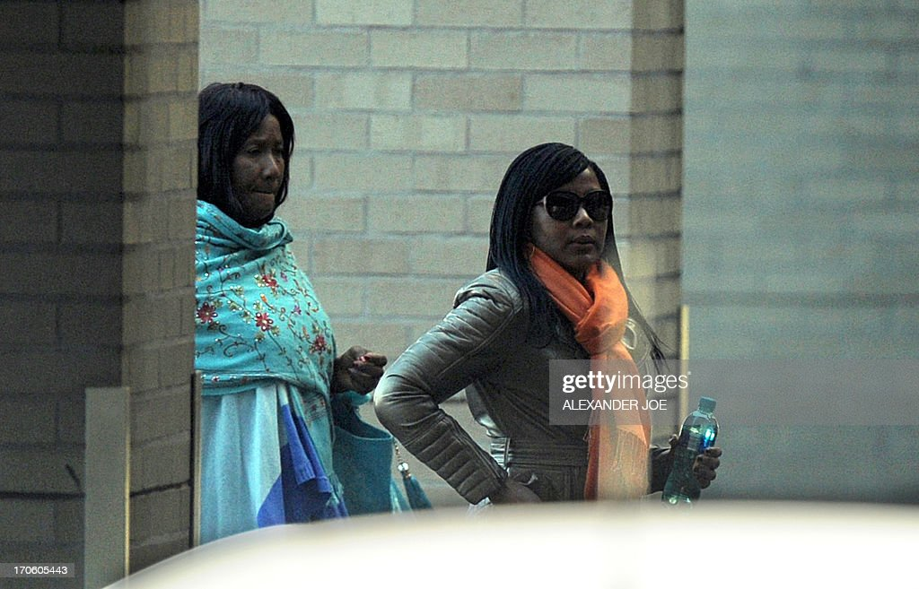 Makazawie Mandela (L), the daughter from the first marriage of former South African President Nelson Mandela, arrives with her daughter Tukwini on June 15, 2013 at the Mediclinic Heart Hospital in Pretoria, where her father has been hospitalized as a result of a recurring lung infection. Nelson Mandela seems to be on the road to recovery from a recurrent lung infection, a grandson said after visiting the anti-apartheid hero in hospital. Mandla Mandela said his 94-year-old grandfather 'looked good' when he visited him in a Pretoria hospital along with two elders. JOE