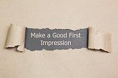 Make a Good First Impression message written under torn paper.