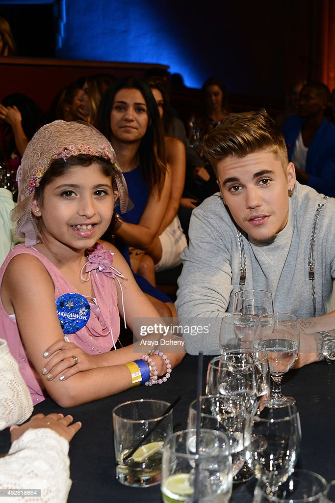 Make a Wish recipient Wish Child Grace and honoree <a gi-track='captionPersonalityLinkClicked' href=/galleries/search?phrase=Justin+Bieber&family=editorial&specificpeople=5780923 ng-click='$event.stopPropagation()'>Justin Bieber</a> (R) attend the 2014 Young Hollywood Awards brought to you by Mr. Pink held at The Wiltern on July 27, 2014 in Los Angeles, California.