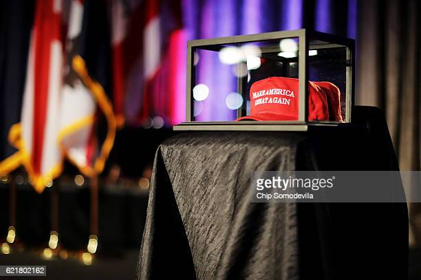 A 'Make America Great Again' hat sits in a glass case during Republican presidential nominee Donald Trump's election night party at the New York...