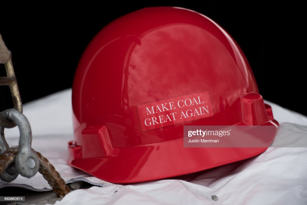 A 'Make Coal Great Again' hard hat sits on a table at the grand opening of Corsa Coal's Acosta Deep Mine on June 8, 2017 in Friedens, Pennsylvania. The mine is expected to create more than 70 new jobs and should produce 400,000 tons of metallurgical coal a year.