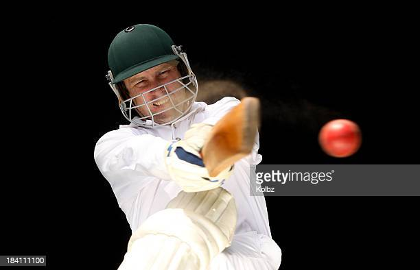 Make cricket player executing shot on red ball against black