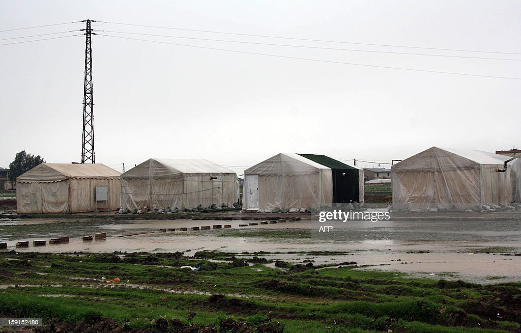 A make shift camp for Syrian refugees in the eastern Lebanese Bekaa Valley, is seen flooded on January 8, 2013, as stormy weather sparked widespread flooding, prompting chaos on the roads and a nationwide school closure for the next two days. The number of Syrian refugees in Lebanon is already totalling 156,000, according to UN figures, and 200,000 according to the Lebanese government estimates.