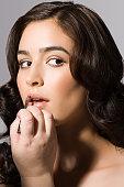 A make up artist applying lipstick to a model