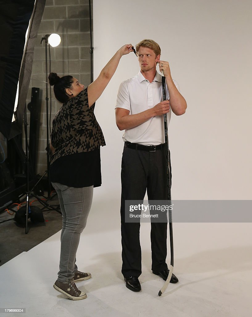Make up artist Fabiola Alarcon prepares Eric Staal of the Carolina Hurricanes for a portrait session during the National Hockey League Player Media Tour at the Prudential Center on September 6, 2013 in Newark, New Jersey.