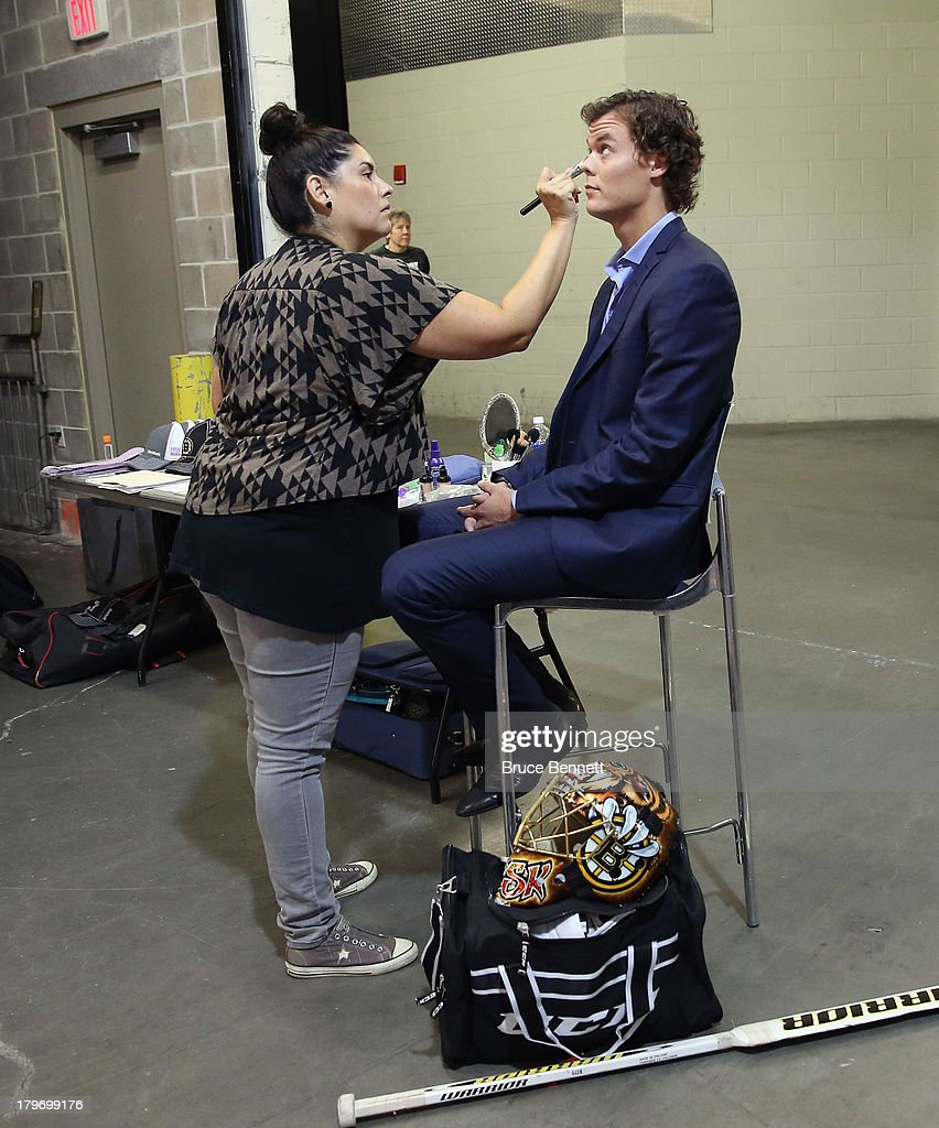 Make up artist Fabiola Alarcon prepares <a gi-track='captionPersonalityLinkClicked' href=/galleries/search?phrase=Tuukka+Rask&family=editorial&specificpeople=716723 ng-click='$event.stopPropagation()'>Tuukka Rask</a> of the Boston Bruins for a portrait session during the National Hockey League Player Media Tour at the Prudential Center on September 6, 2013 in Newark, New Jersey.