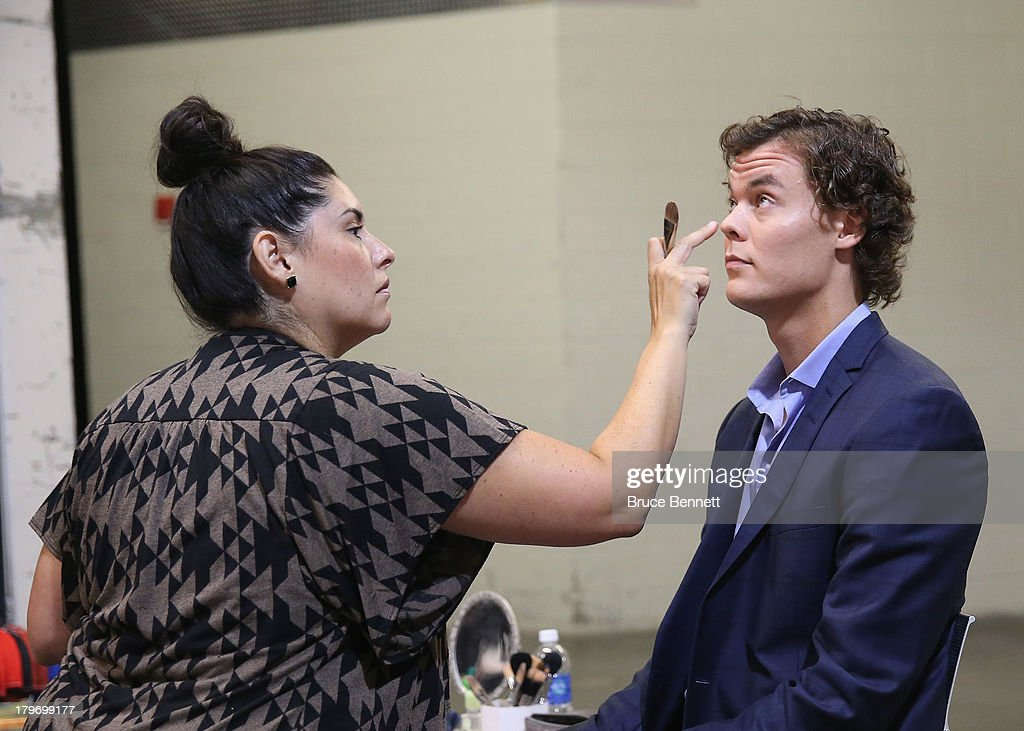 Make up artist Fabiola Alarcon prepares Tuukka Rask of the Boston Bruins for a portrait session during the National Hockey League Player Media Tour at the Prudential Center on September 6, 2013 in Newark, New Jersey.