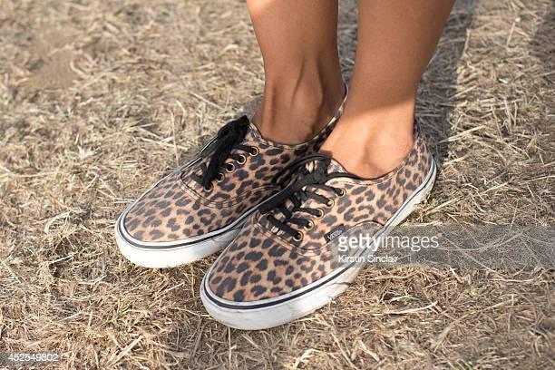 Make up artist Kat Ali wearing Vans trainers Topshop boutique playsuit vintage Mulberry bag Primark sunglasses and a Matalan scraf at Lovebox 2014 on...